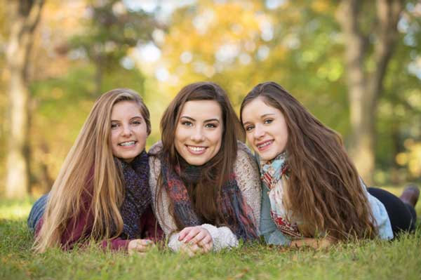 girls smiling on grass